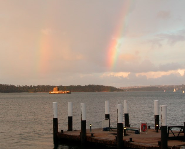 View of Sydney Harbour with Fort Denison framed by two Rainbows