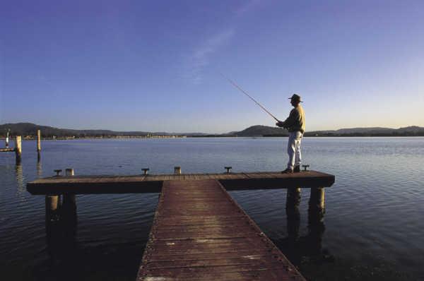 Man fishing off jetty, Brisbane Water