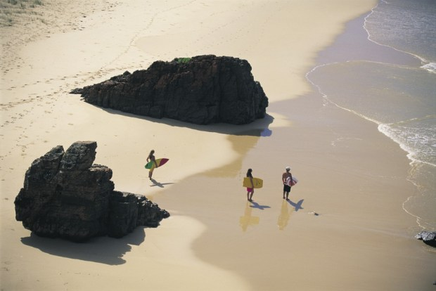 Surfers with their boards at Hat Head National Park - Photo Don Fuchs, Tourism NSW