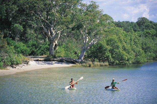 Kayakers on aqua waters at South West Rocks, Kempsey, North Coast