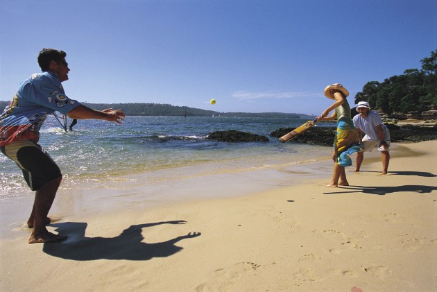 Combining beach with a cricket bat and a tennis ball